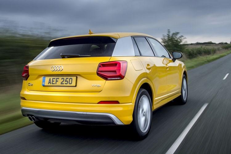 Yellow 2019 Audi Q2 SUV rear three-quarter driving