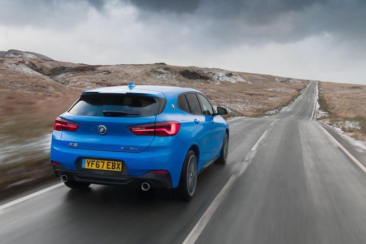 Blue 2017 BMW X2 SUV rear three-quarter driving