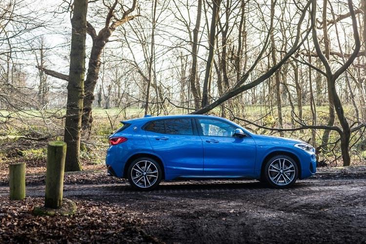 Blue 2017 BMW X2 SUV side elevation