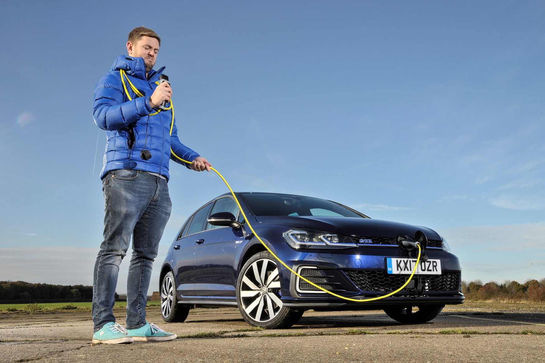 Blue 2017 Volkswagen Golf GTE front three-quarter with Adam Binnie