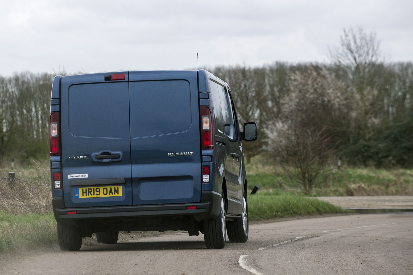 Renault trafic review - facelift, rear view, driving, 2020, blue