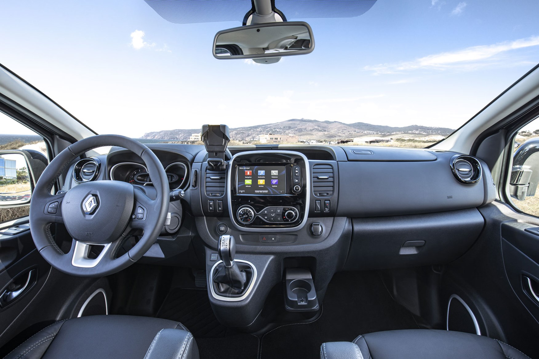 Renault Trafic review - 2019 facelift, cab interior showing whole dashboard, steering wheel, infotainment