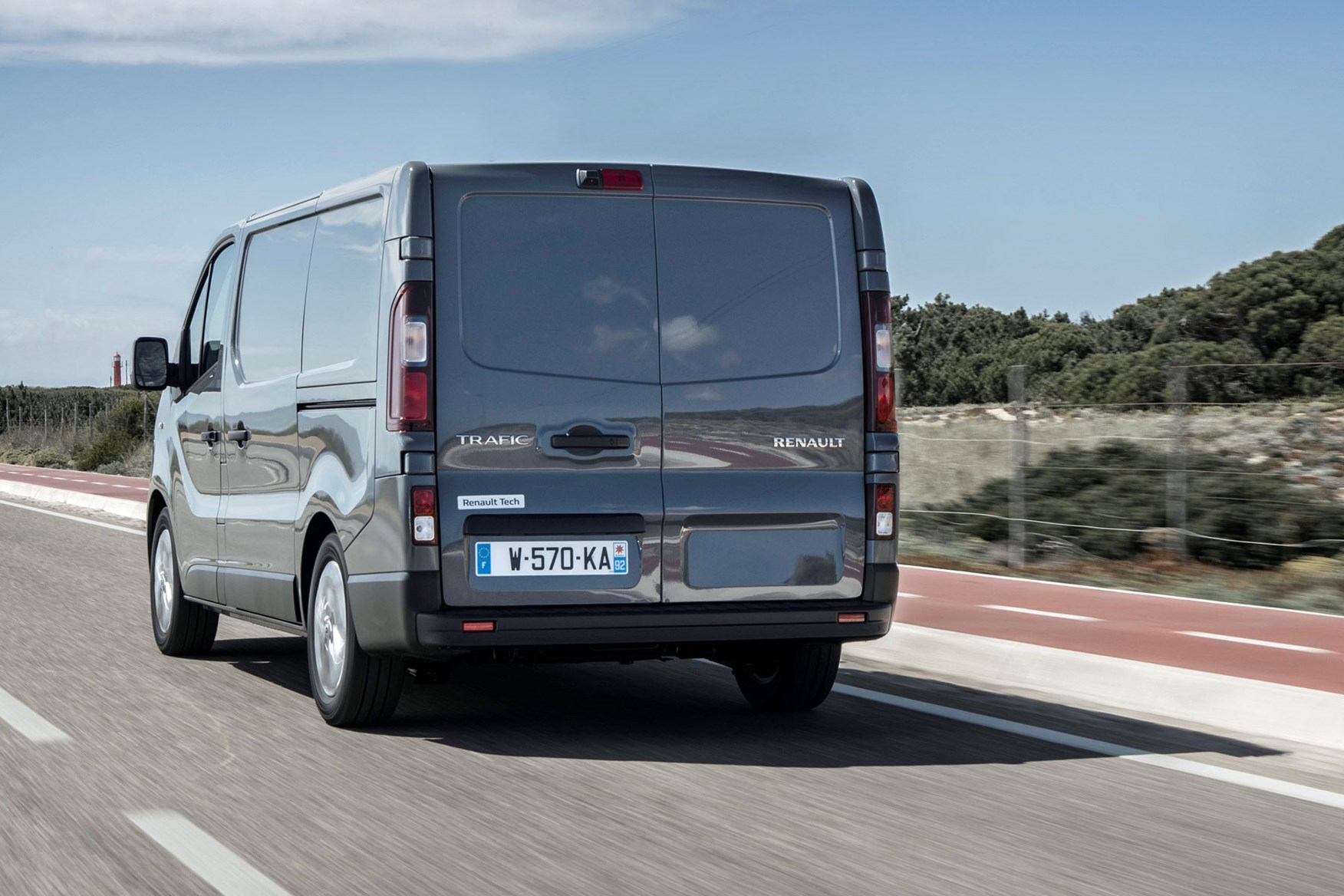 Renault Trafic review - 2019 facelift, rear view, driving, grey
