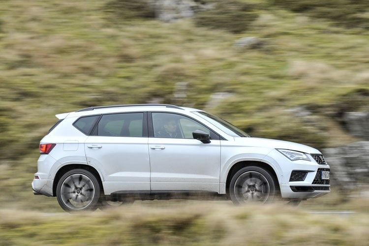 White 2019 Cupra Ateca SUV side elevation driving