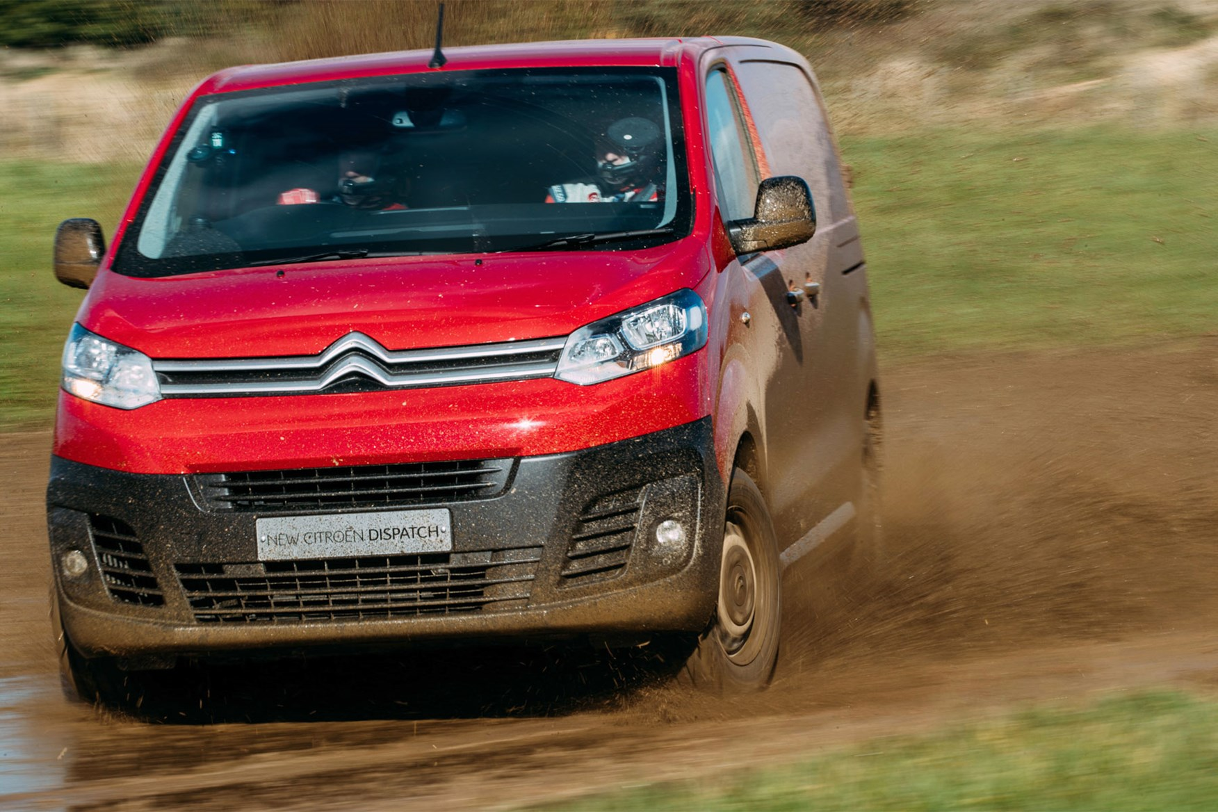 Citroen Dispatch review - front view, red, driving through mud, sideways...