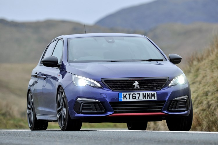 Blue and black 2017 Peugeot 308 GTI