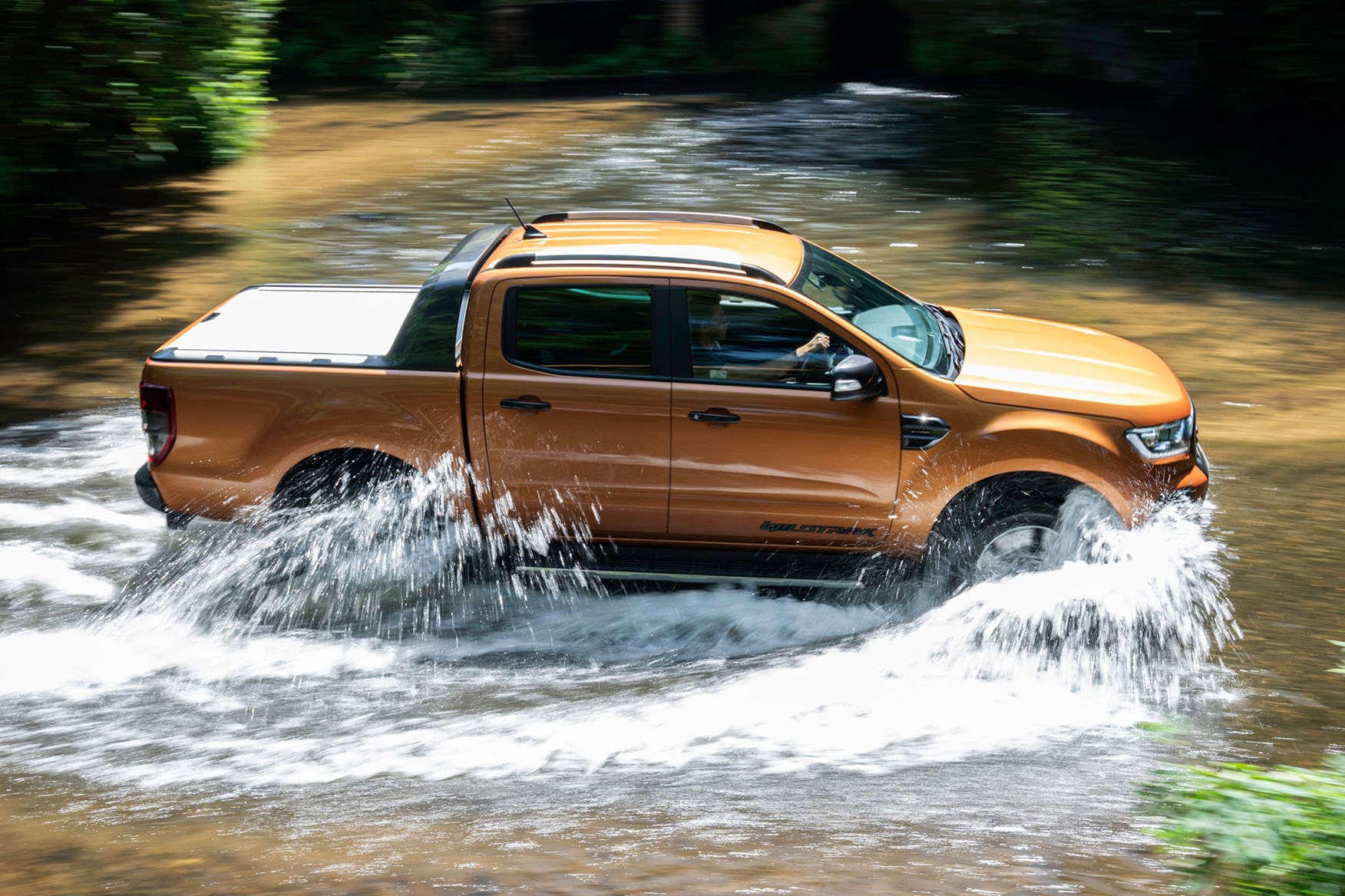 Ford Ranger review - 2019 facelift, side view, wading through water, Wildtrak, orange