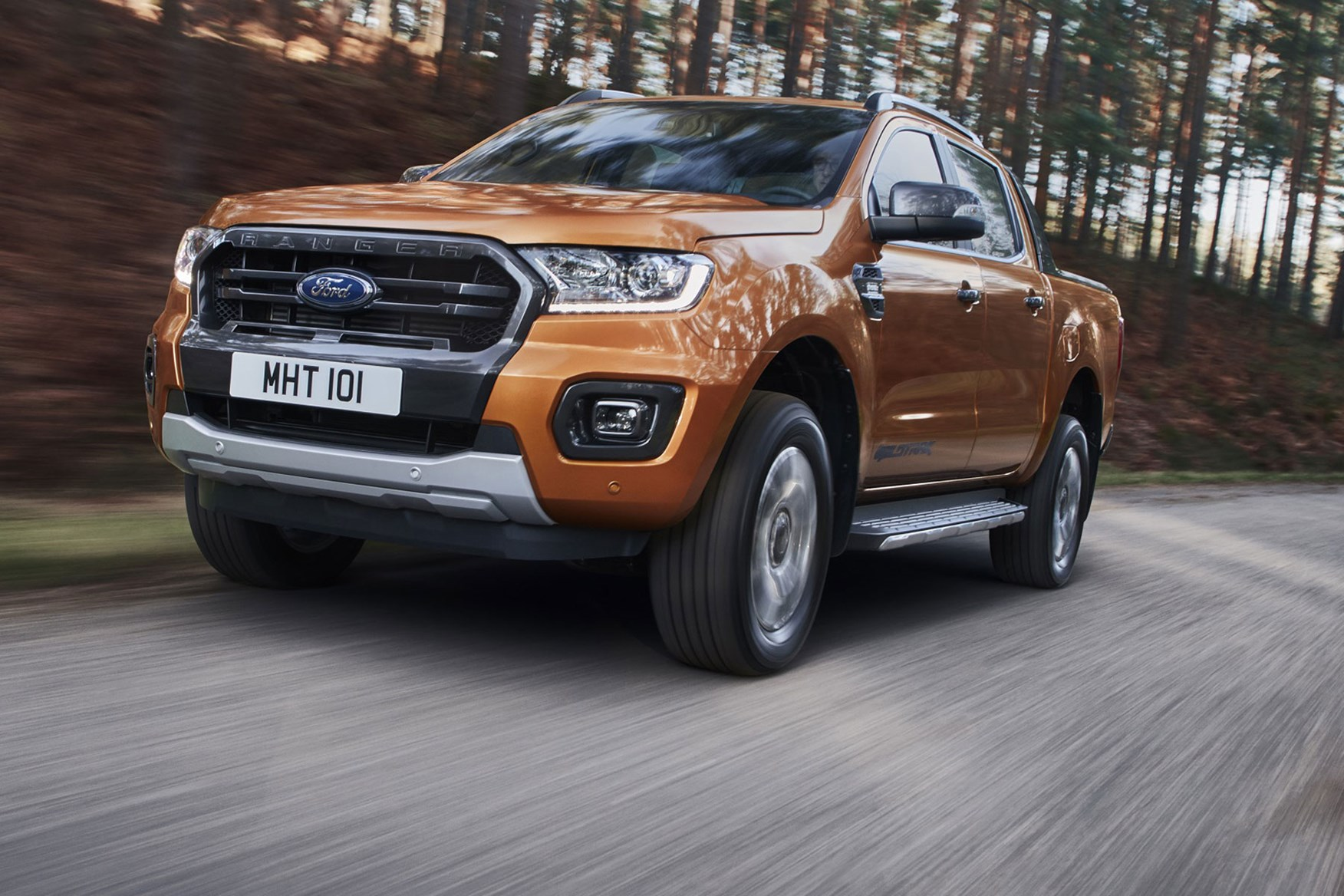 Ford Ranger review - 2019 facelift, front view, driving, WIldtrak, orange