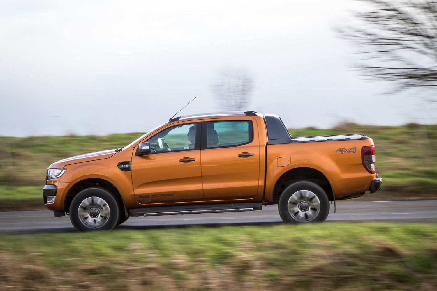 Ford Ranger review - 2016 facelift, side view, driving, Wildtrak, orange