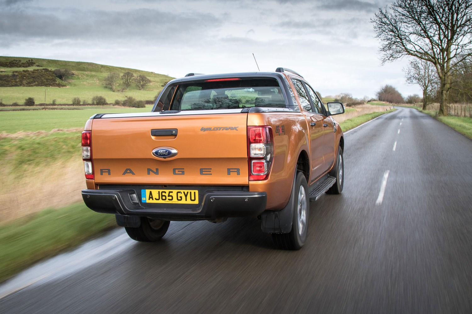 Ford Ranger review - 2016 facelift, rear view, driving, orange Wildtrak