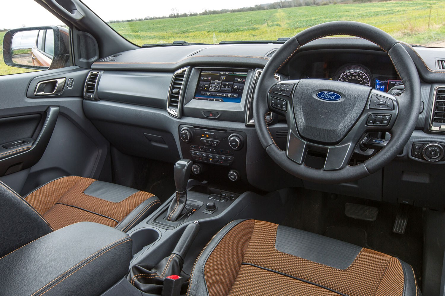 Ford Ranger review - 2016 facelift cab interior showing seats, steering wheel and dashboard
