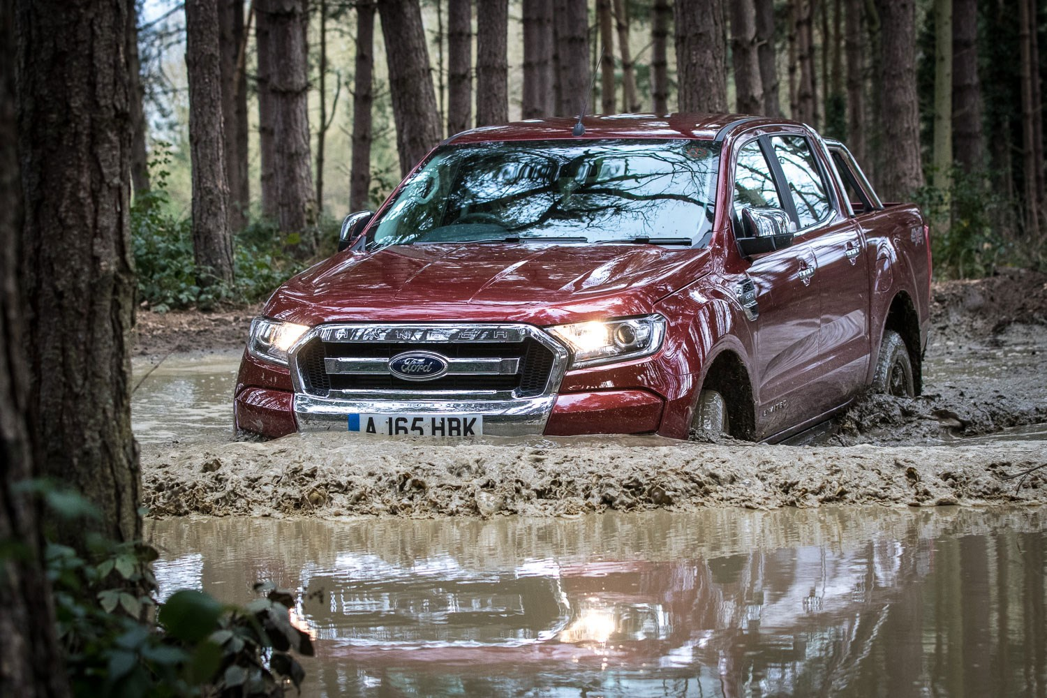 Ford Ranger review - 2016 facelift, wading through mud, dark red metallic, Limited