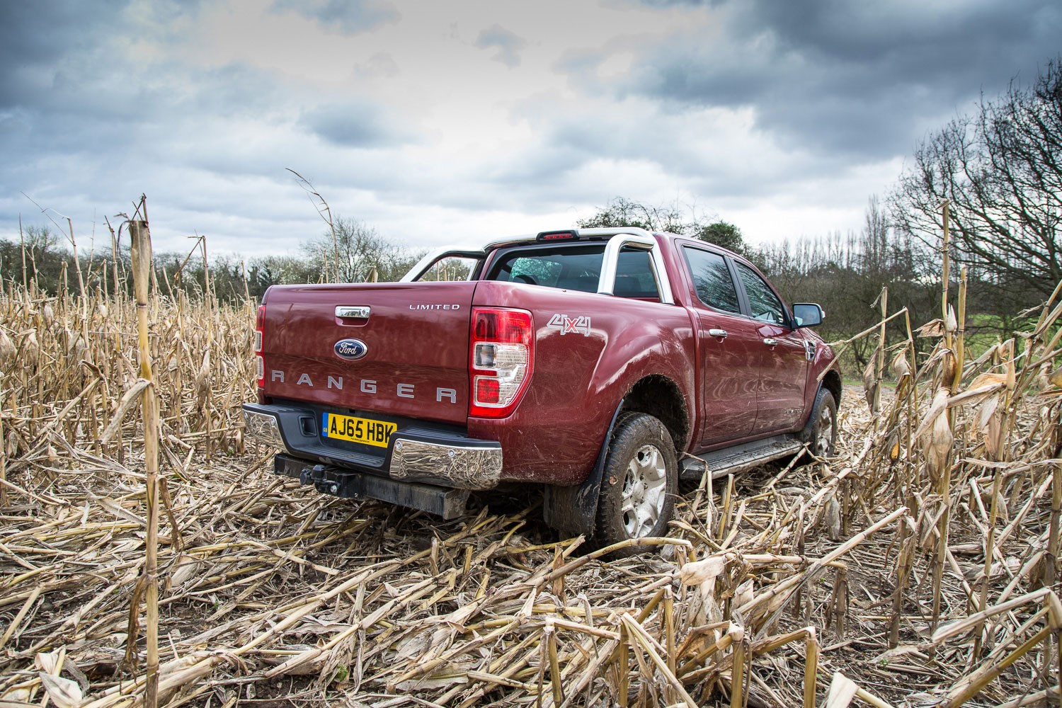 Ford Ranger review - 2016 facelitt, rear view, parked in field of crops, dark red