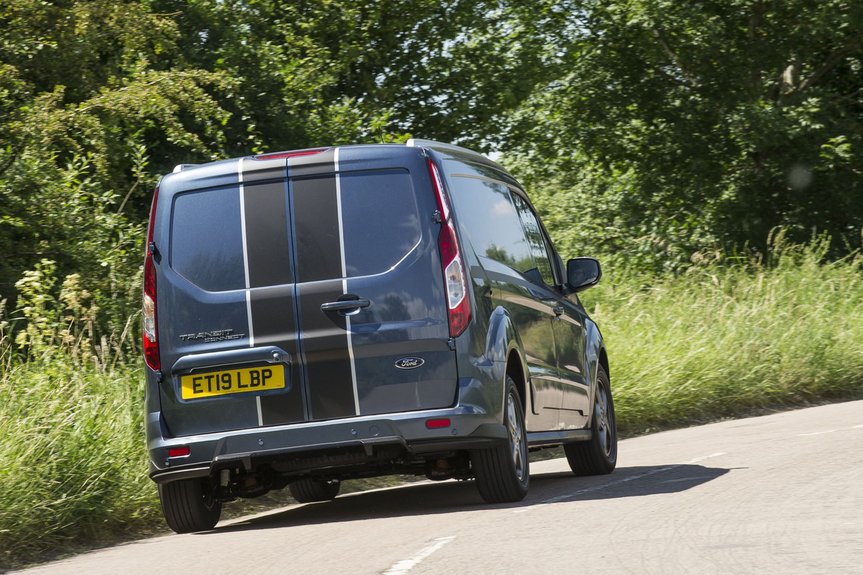 Ford Transit Connect review - 2018 Sport Van, rear view, driving round corner, Chrome Blue
