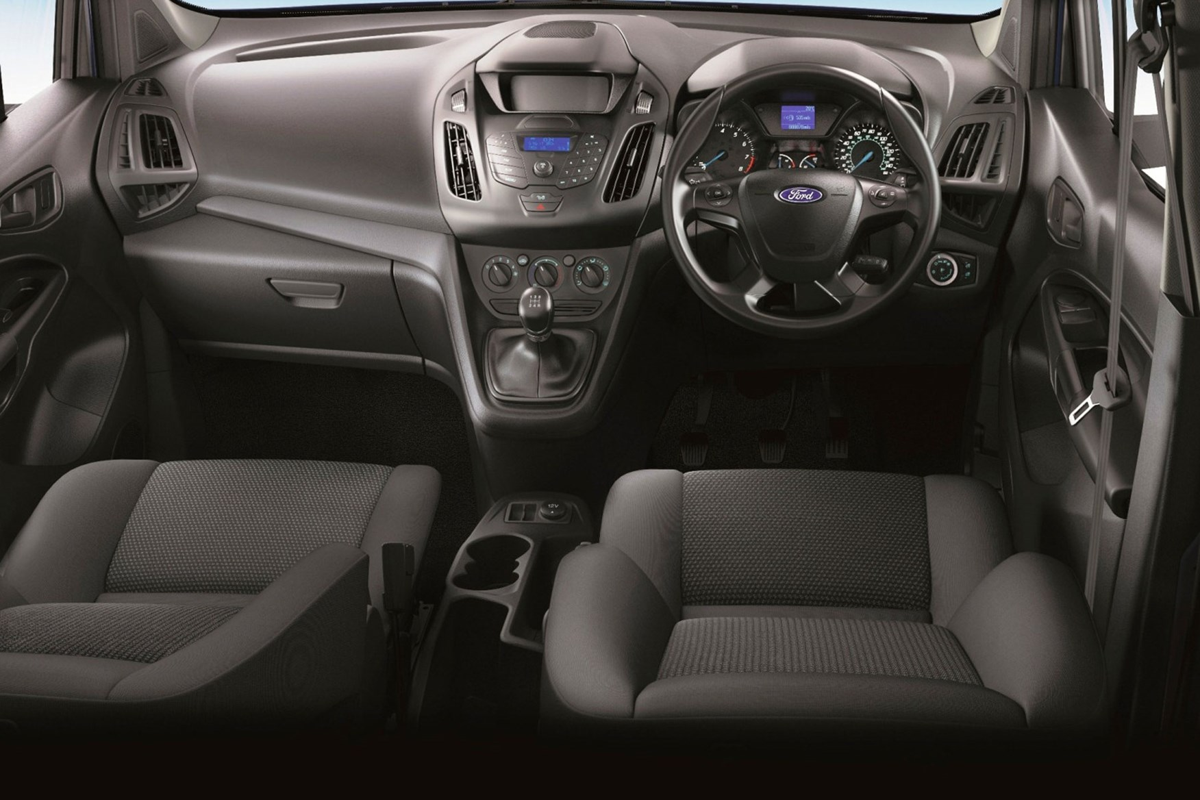 Ford Transit Connect review - 2013 cab interior showing steering wheel and dashboard, basic radio, lots of buttons