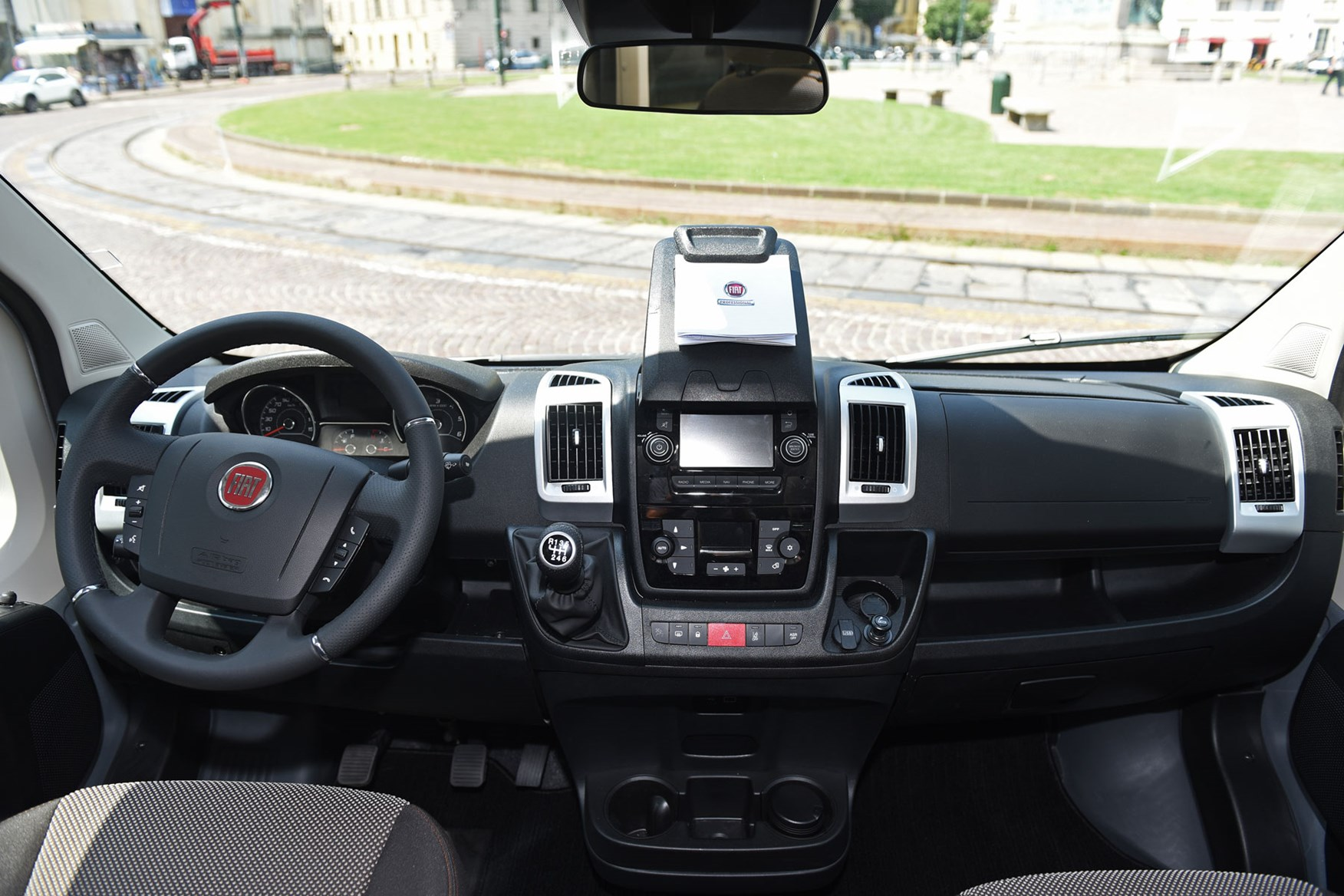 Fiat Ducato review - 2019 MY20 cab interior, wide view showing whole dashboard, tablet holder, steering wheel not straight