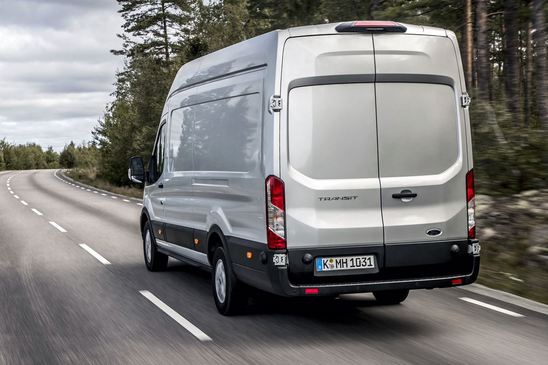 Ford Transit review - 2019 facelift model, rear view, driving, silver
