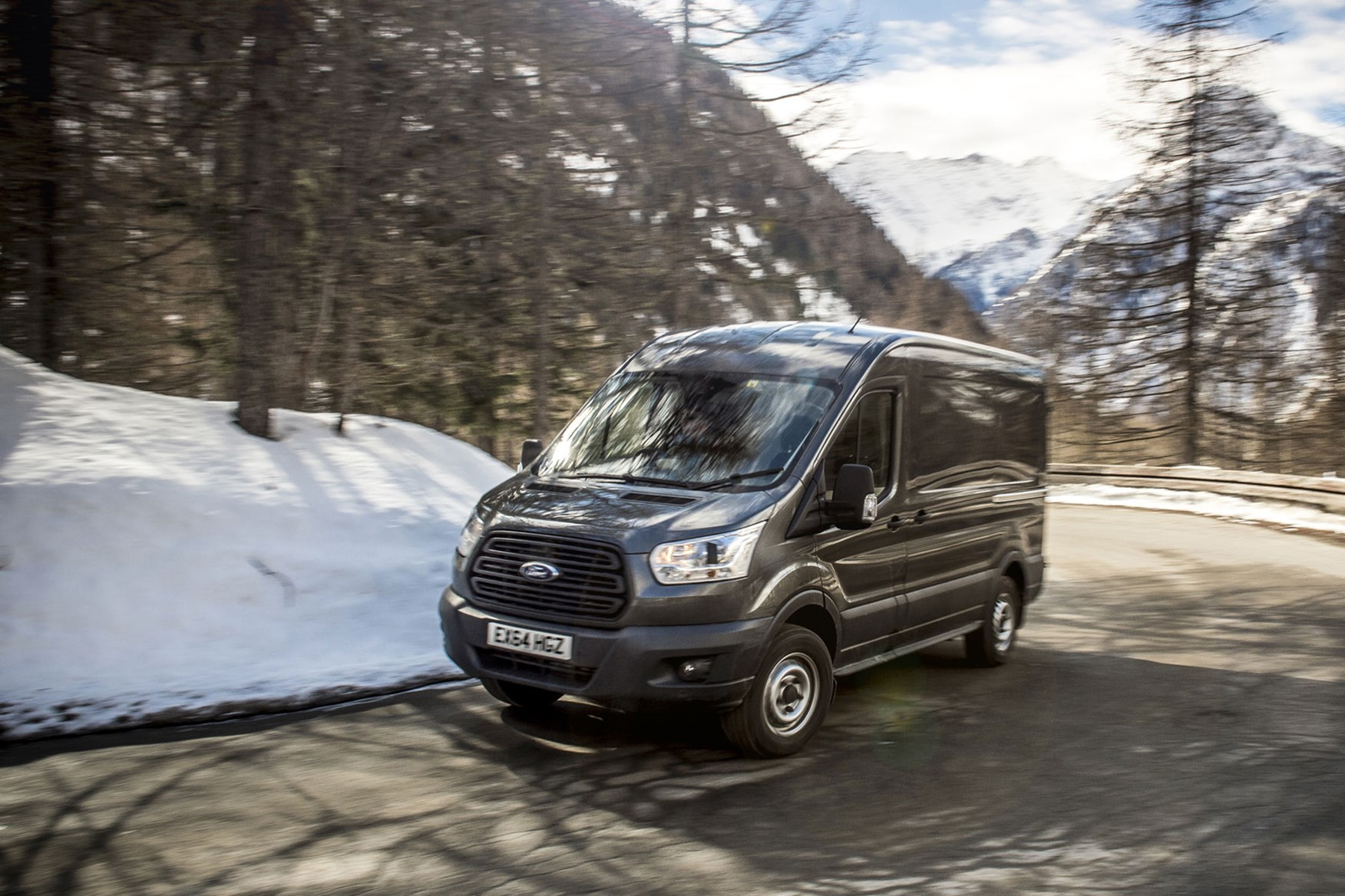 Ford Transit AWD review - front view, driving on mountain road