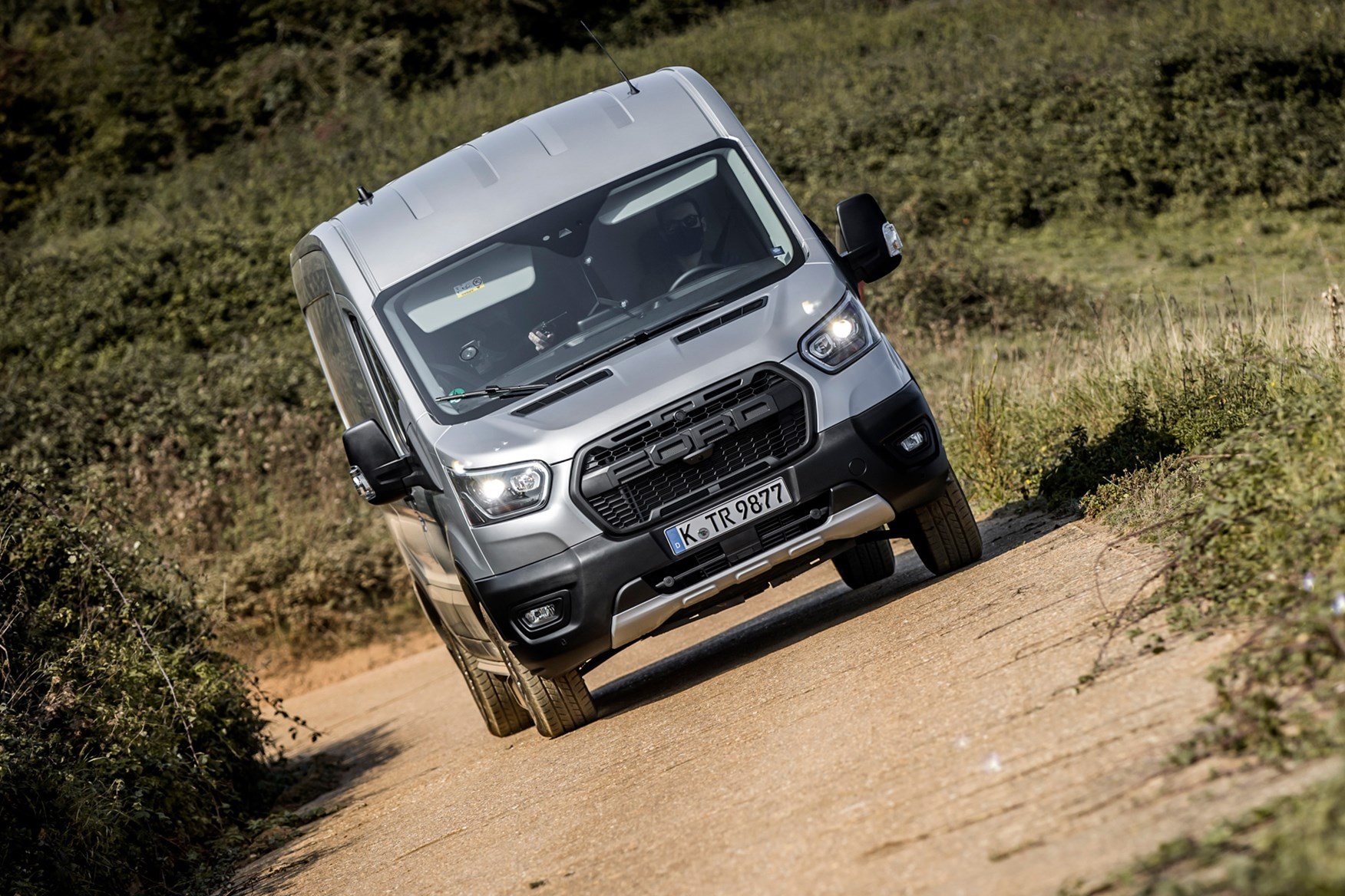 Ford Transit Trail review, 2020, all-wheel drive, AWD, 4x4, front view, driving off-road on side slope
