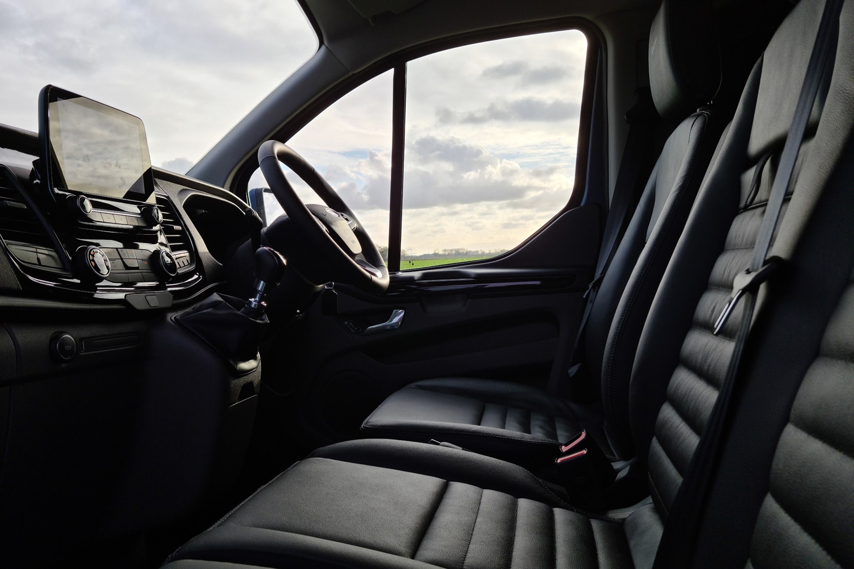 Ford Transit Custom Trail review, L2, DCiV, 2020, black leather front seats