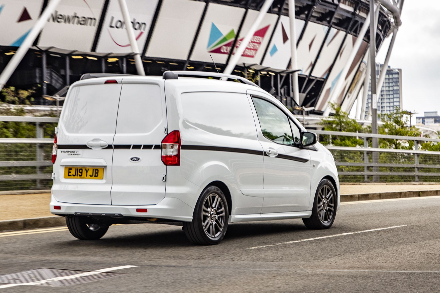 Ford Transit Courier review, 2019 facelift model, rear view, white, driving, Sport