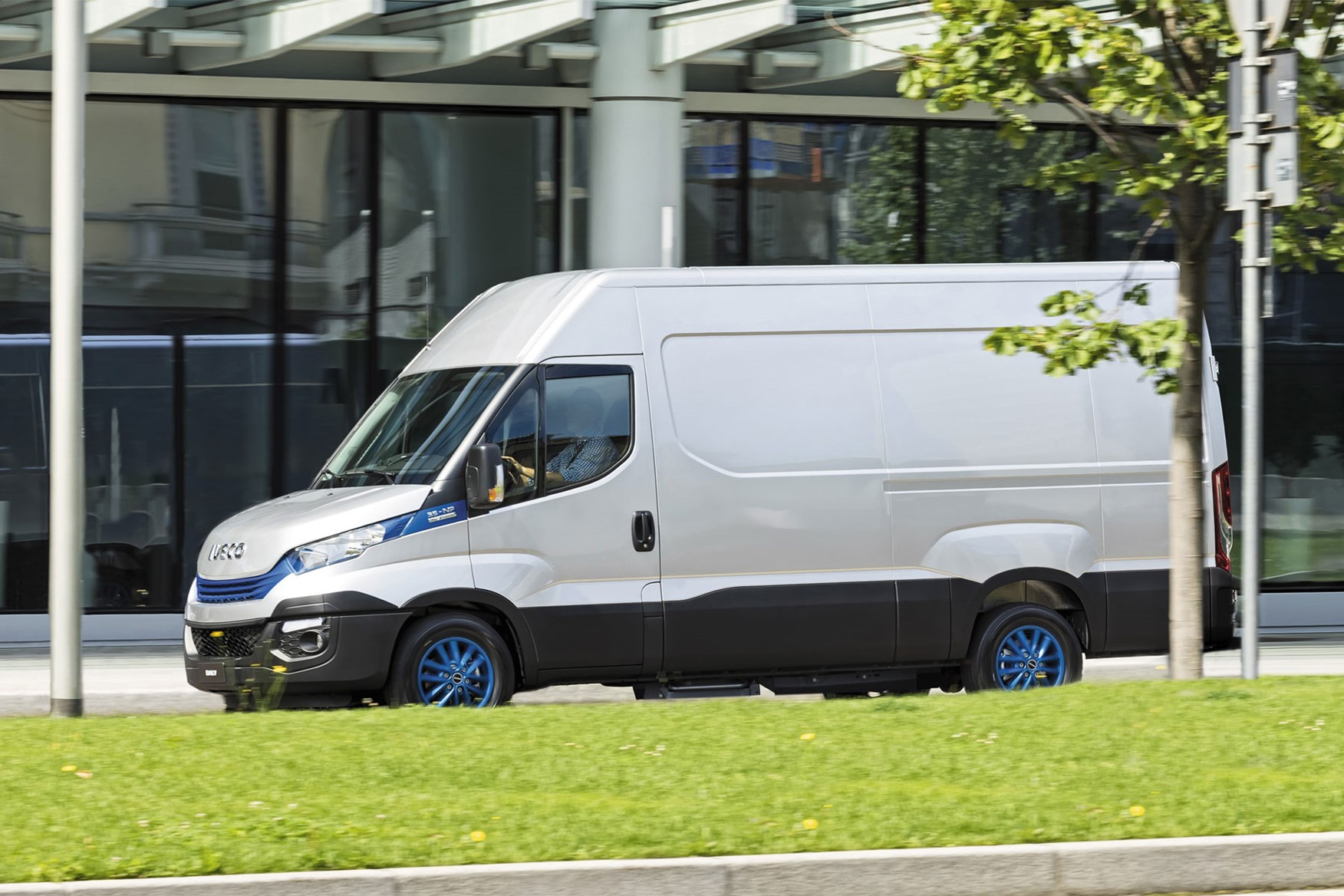 Iveco Daily Blue Power, side view, driving, tree, lamp post