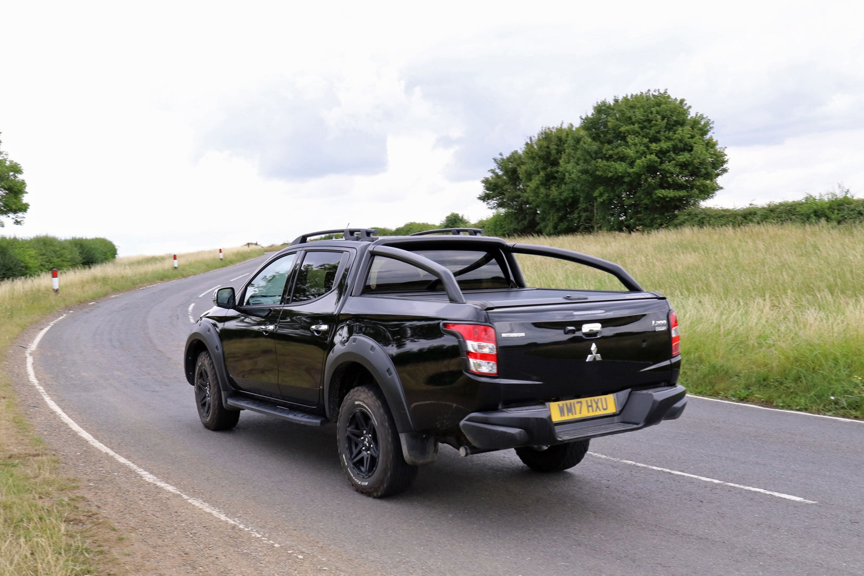 Mitsubishi L200 review, black Barbarian SVP, driving, rear view