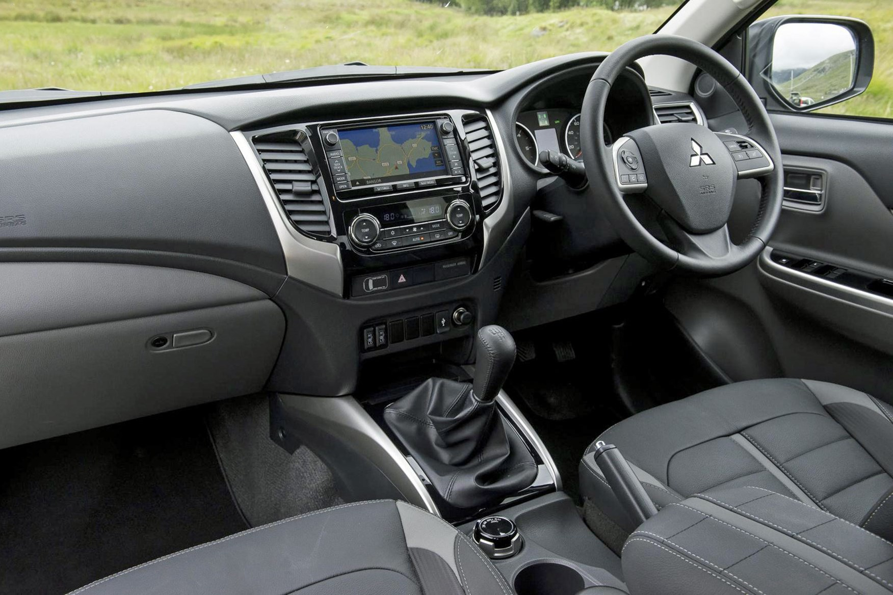 Mitsubishi L200, cab interior, lifestyle with touchscreen