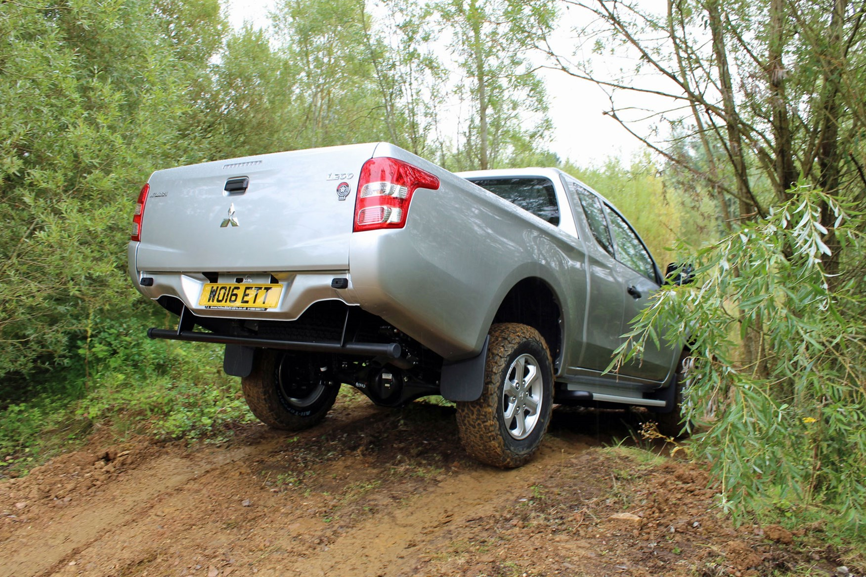 Mitsubishi L200 4Life Club Cab review - rear view, driving off-road, silver