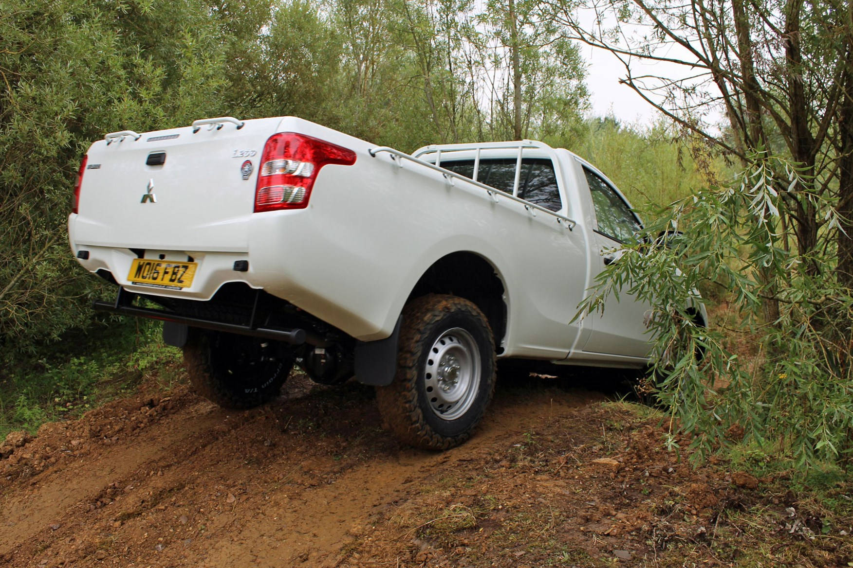 Mitsubishi L200 4Life Single Cab review - rear view, driving off-road, white