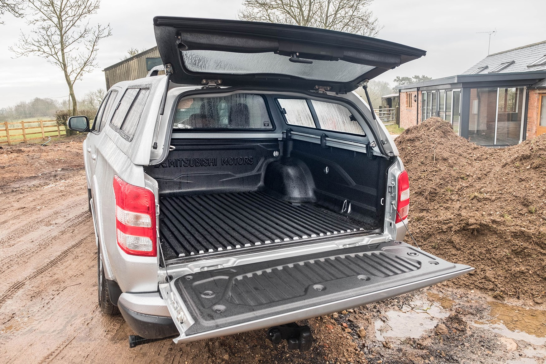 Mistubishi L200 Warrior 2018 review - rear view with Truckman top, silver, tailgates open