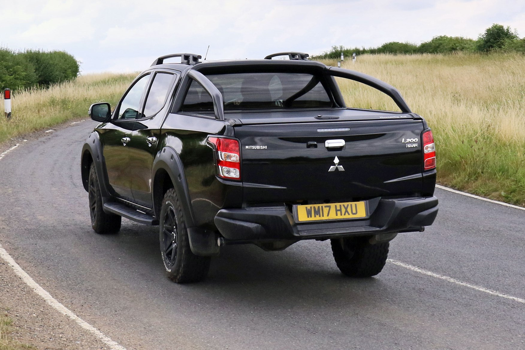 Mitsubishi L200 Barbarian SVP review - rear view, driving on country road