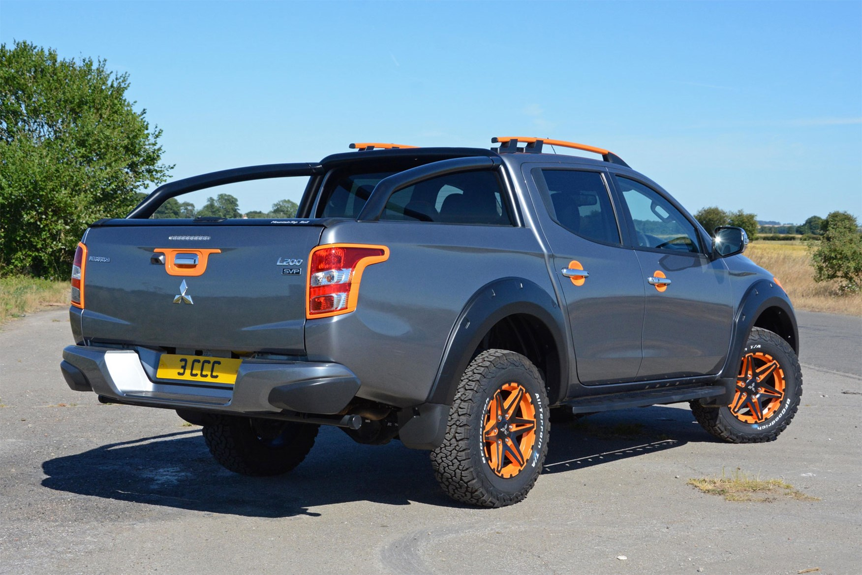 Mitsubishi L200 Barbarian SVP II review - grey and orange, rear view