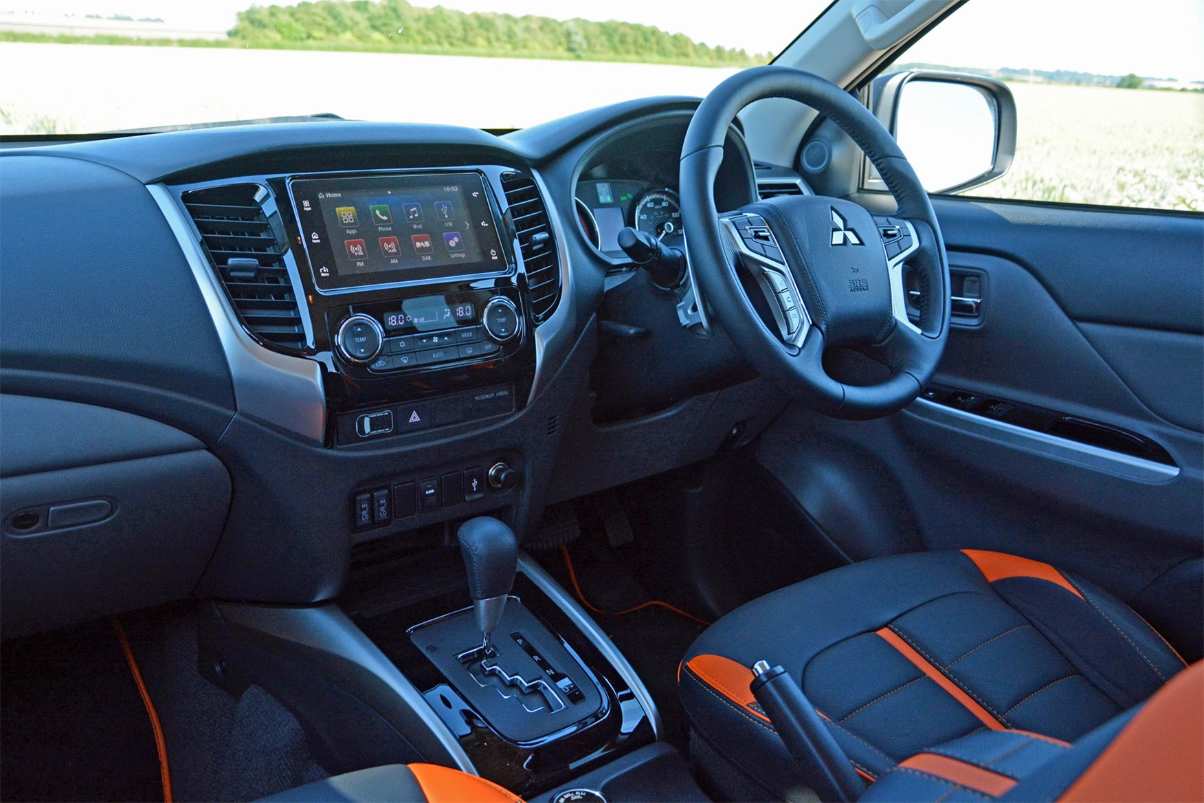 Mitsubishi L200 Barbarian SVP II review - cab interior, steering wheel, dash board, black and orange