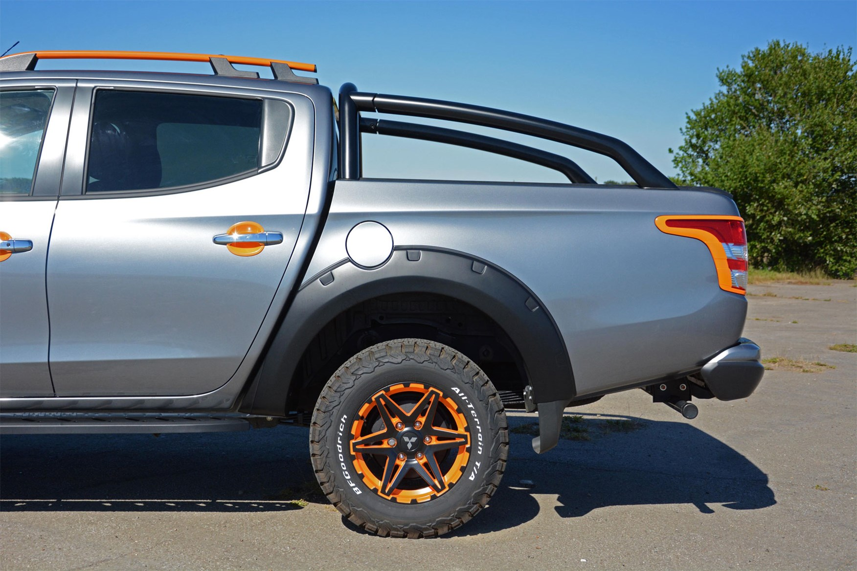 Mitsubishi L200 Barbarian SVP II review - rear side detail showing wheels, tyres, arch extensions, light surrounds