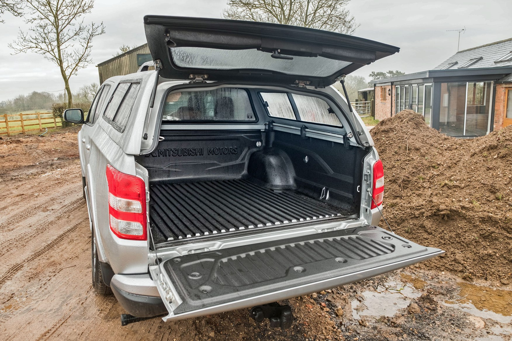 Mitsubishi L200 review, silver, rear view, load area with hard top