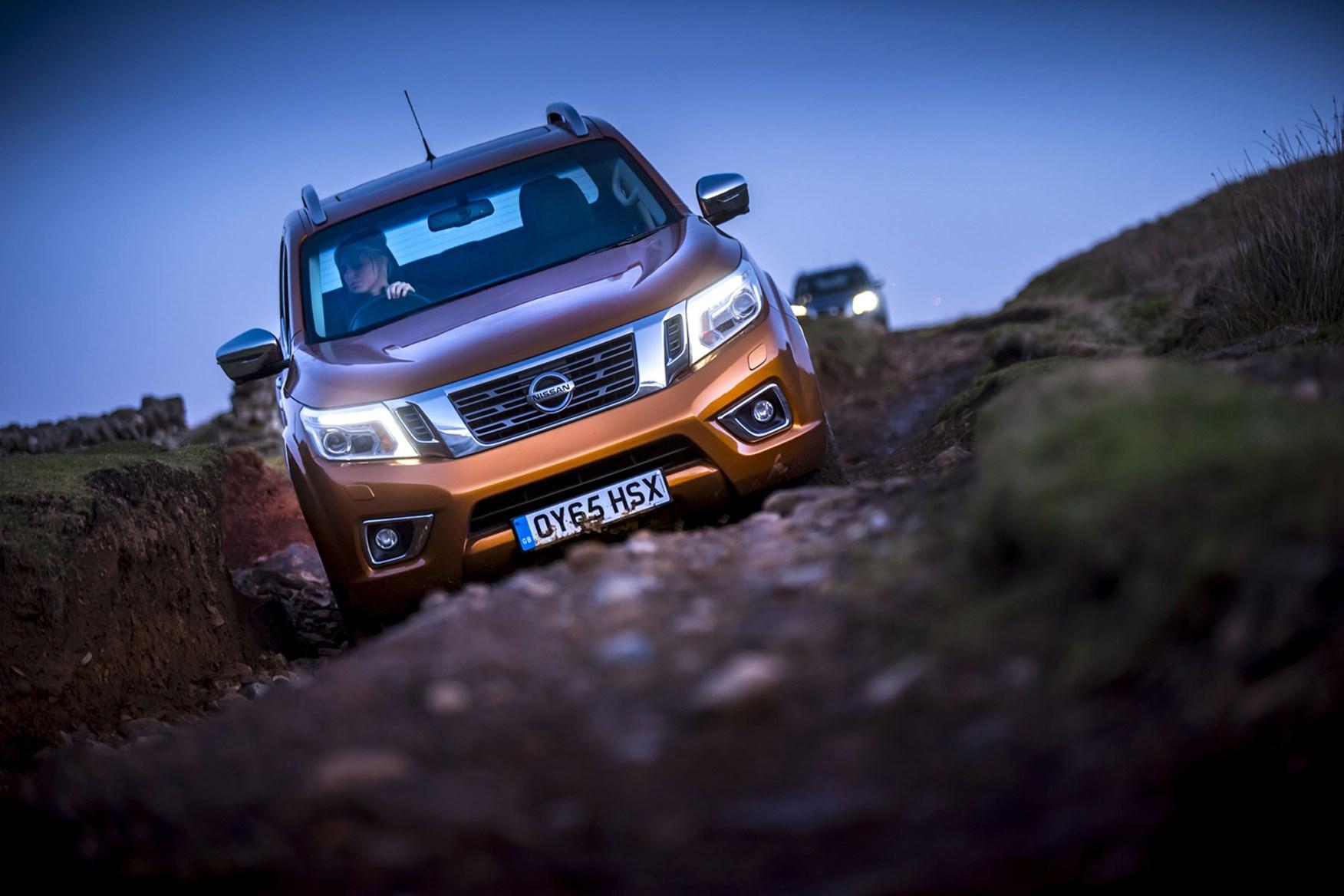 Nissan Navara review - front view, orange, driving off-road