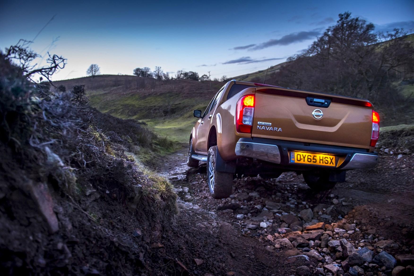 Nissan Navara review - rear view, orange, driving off-road