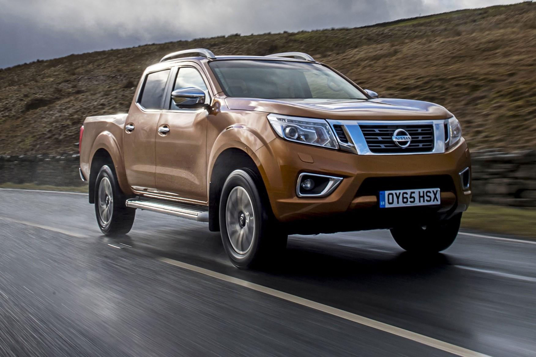 Nissan Navara review - front view, driving, orange