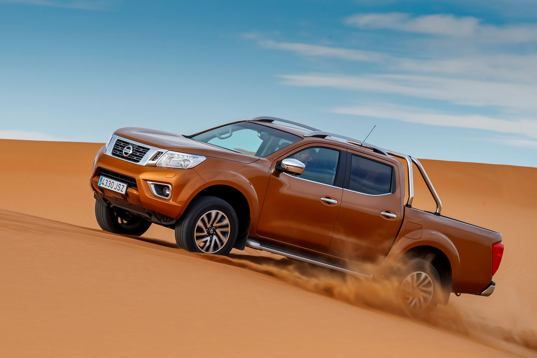 Nissan Navara Tekna review - driving in the Sahara Desert, side view, orange, climbing dune