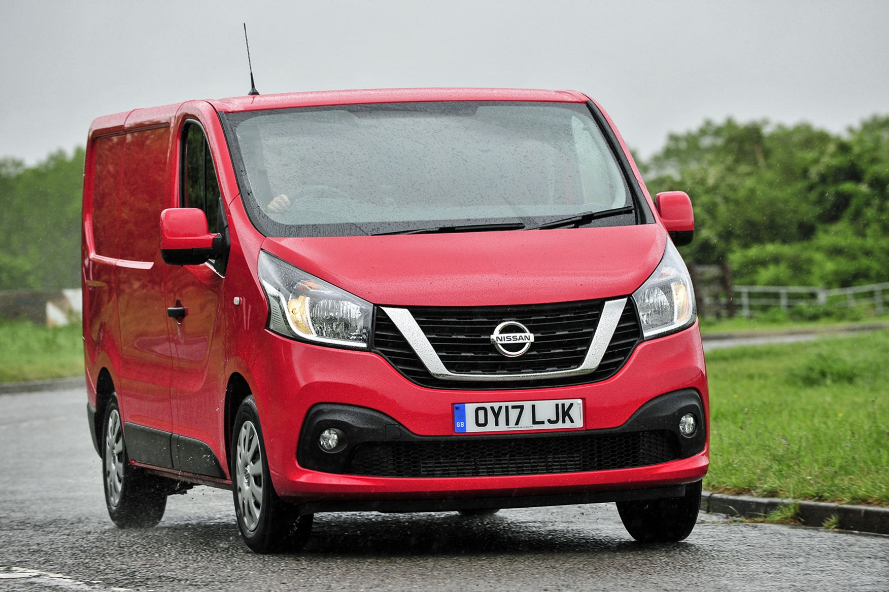 Nissan NV300 - red, front view, UK, driving in the rain, 2017