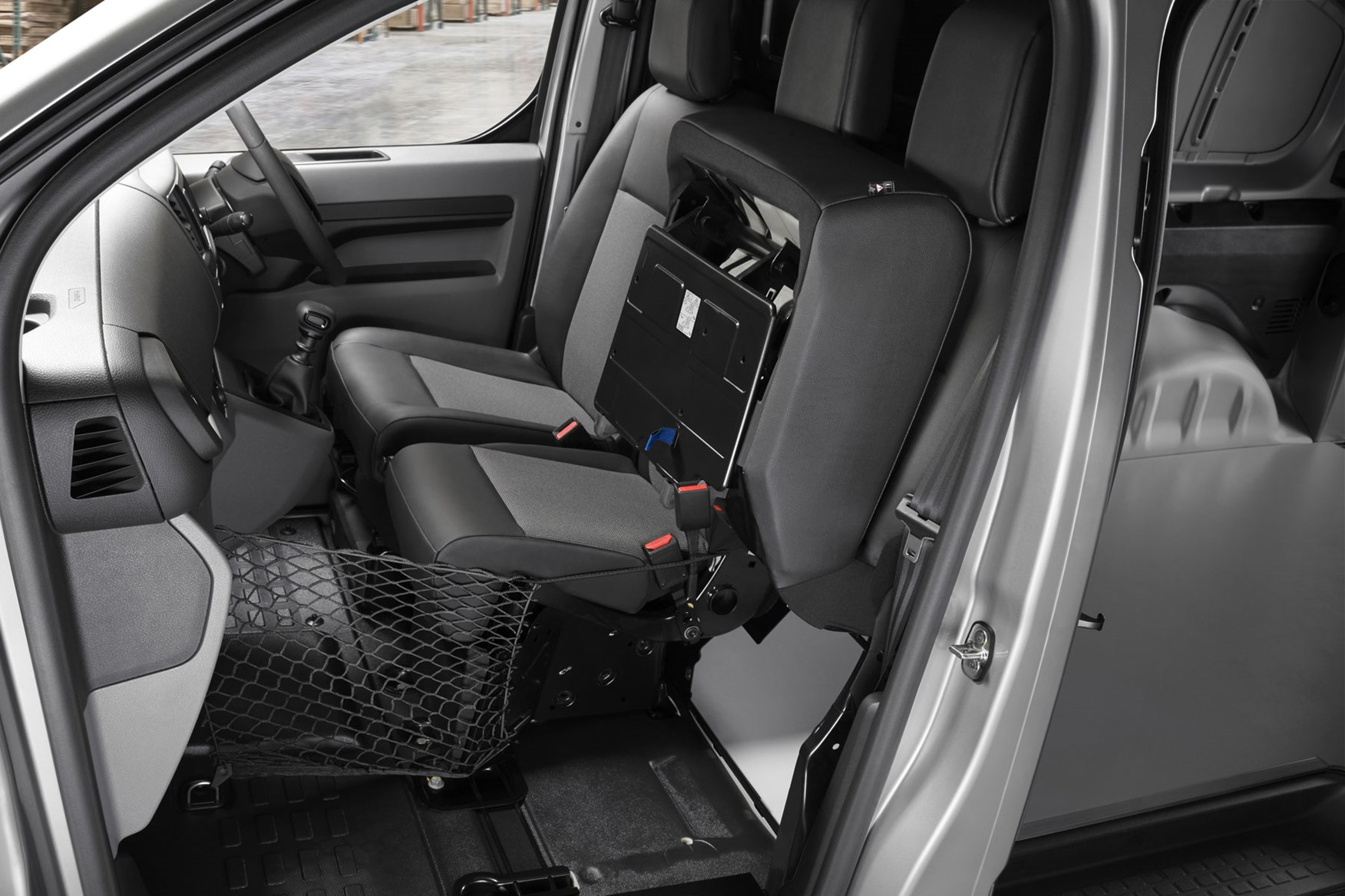 Peugeot Expert - 2016 model, cab interior viewed from passenger side, Moduwork bulkhead with passenger seat folded up and net fitted