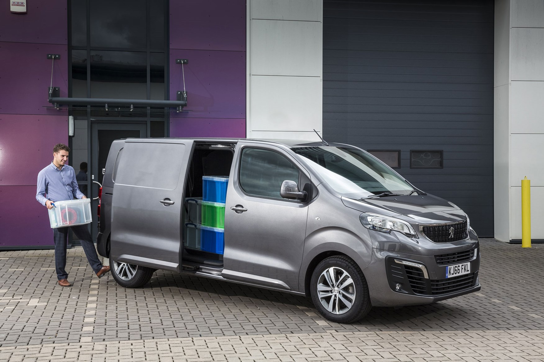 Peugeot Expert - 2016 model, front view, loaded van with man activating electric side doors with foot
