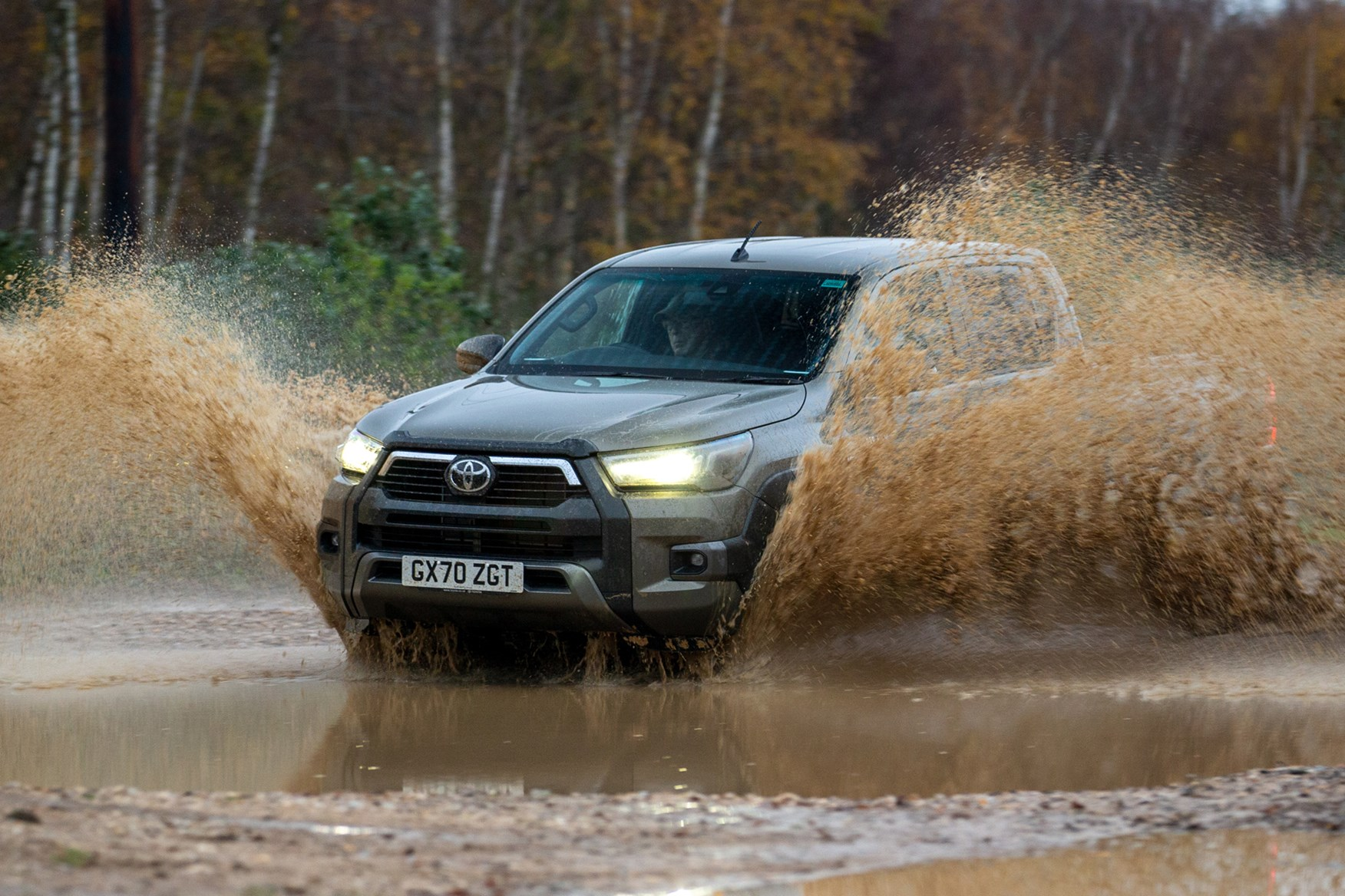 Toyota Hilux review, 2020 facelift, front view, big splash through muddy water, bronze