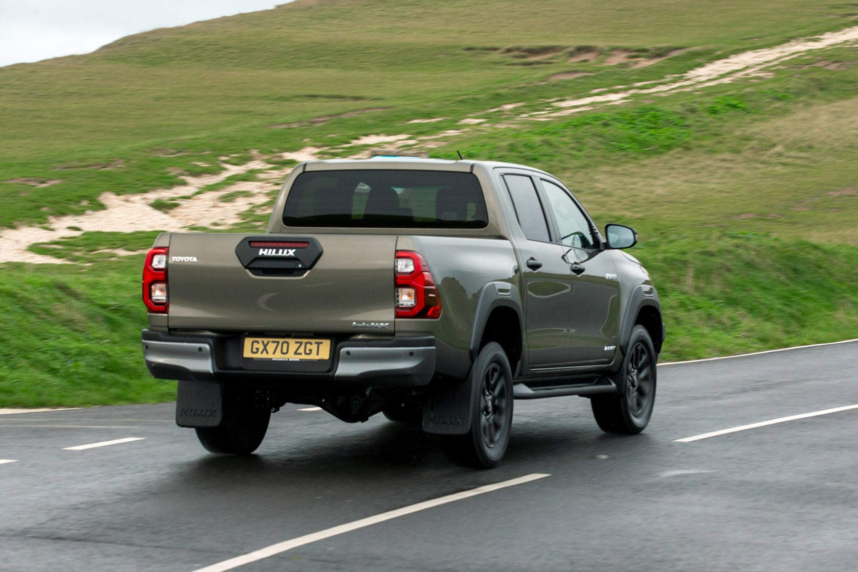 Toyota Hilux review, 2020 facelift, Invincible X, driving, rear view, bronze
