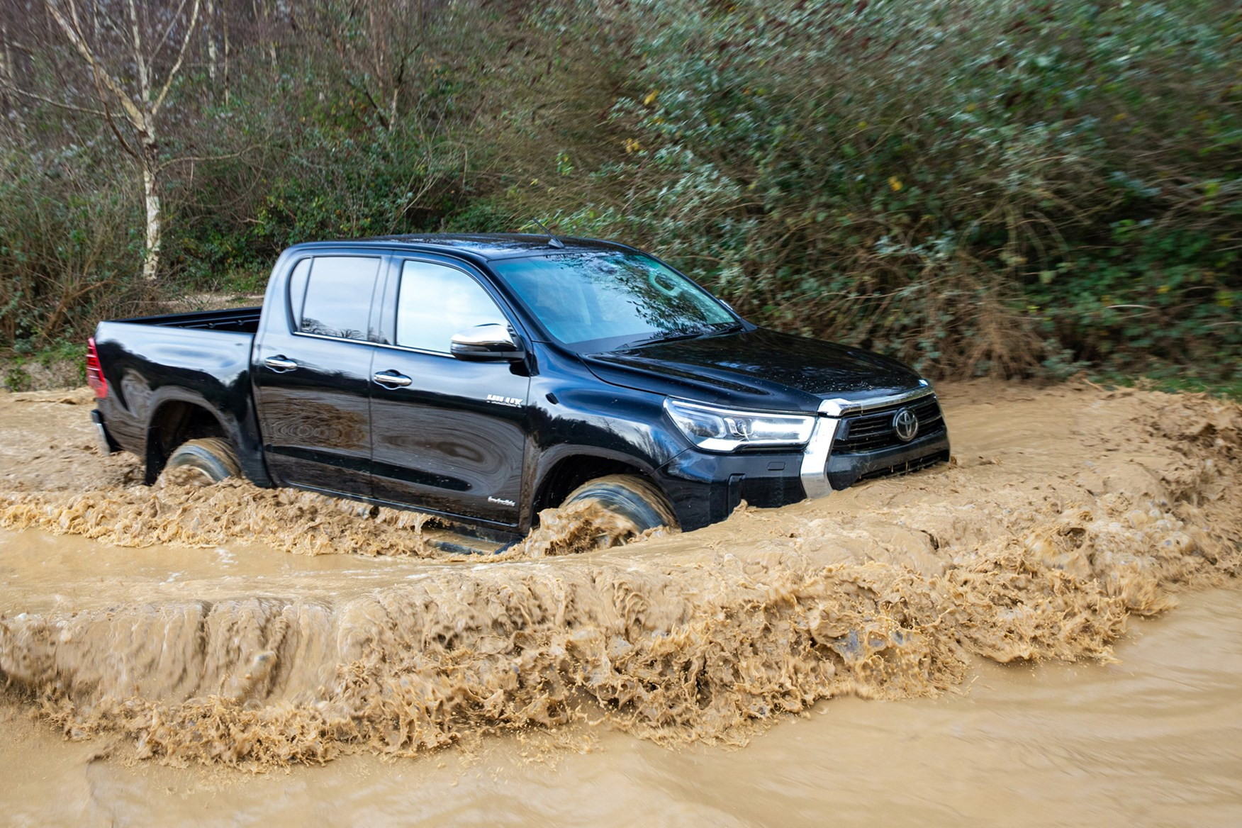 Toyota Hilux review, 2020 facelift, Invincible, bow wave in muddy water, black