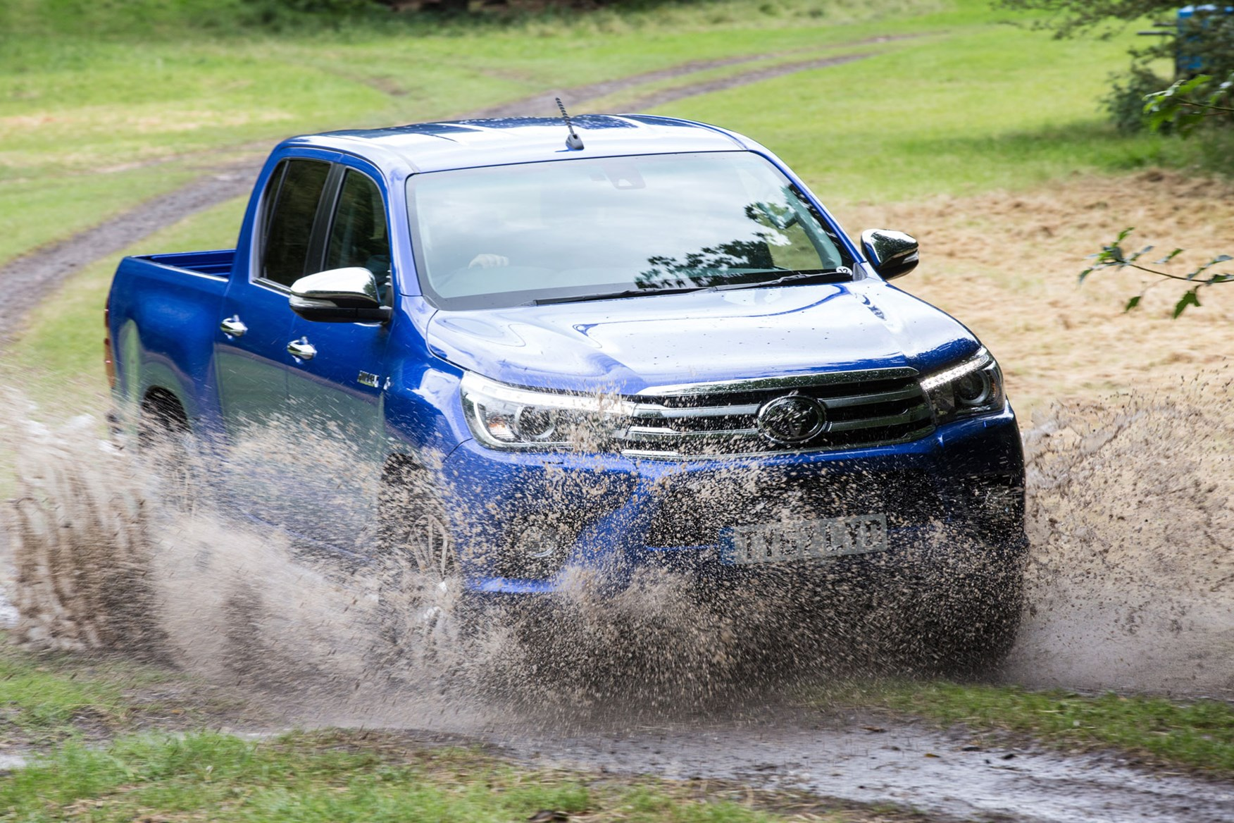 Toyota Hilux review - front view, splashing through water, blue