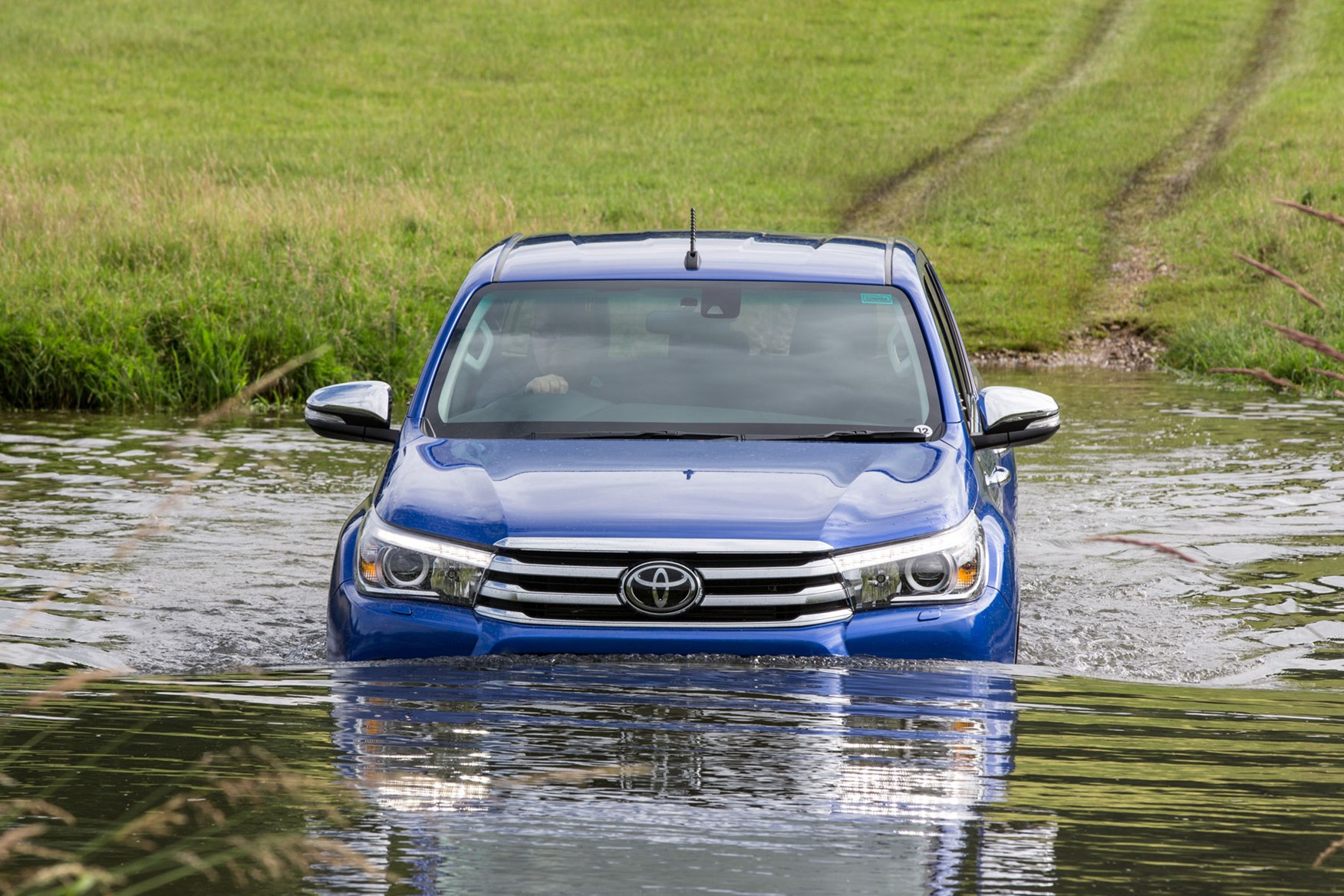 Toyota Hilux review - blue, wading through river
