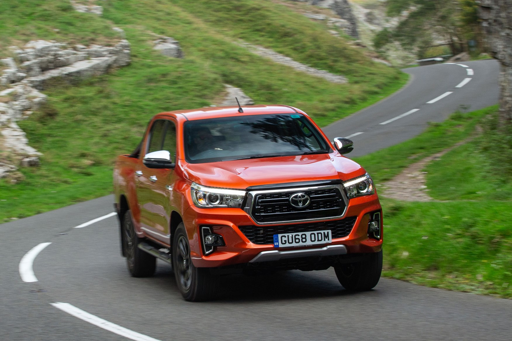 Toyota Hilux review - front view, driving, Invincible X, orange