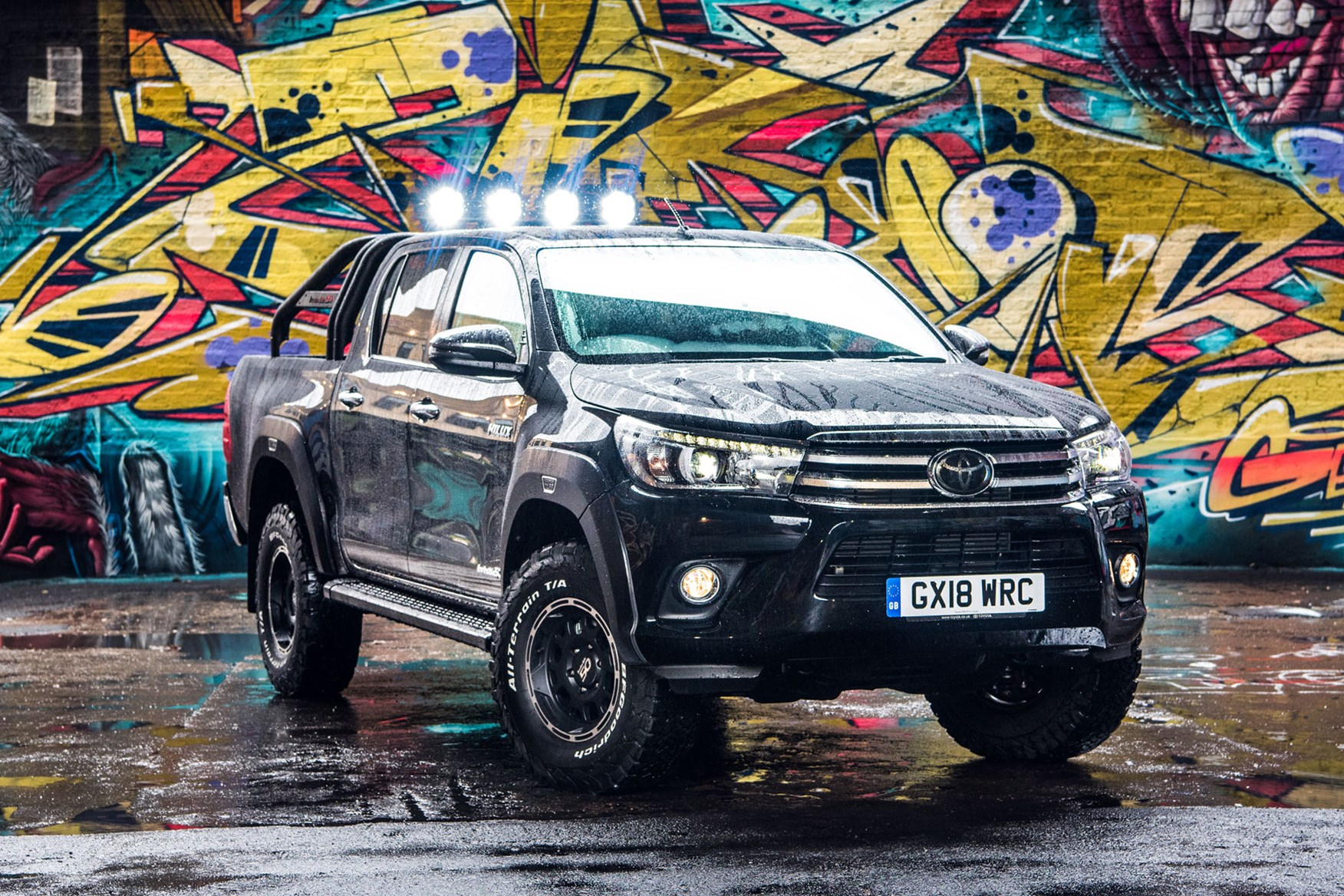 Toyota Hilux review - Invincible 50 special edition, black, front view, spotlights on